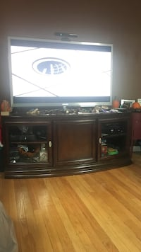 Wooden TV stand with three storage cabinets. Lynbrook, 11563