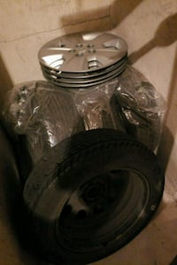 four silver wheel hubcaps and vehicle tires Mississauga, L4X