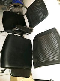 two black leather padded chairs El Paso, 79907