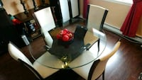 round glass top table with four chairs dining set Laval, H7V 3Z7