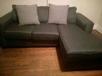 black fabric sectional sofa with throw pillows 69 km