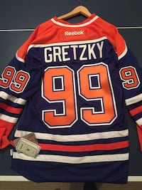 GREATEST OF ALL TIME!!!  Officially licensed & BRAND NEW!!  Reebok WAYNE GRETZKY throwback jersey. Royal blue. Never before worn. Size XL. Langley, V1M