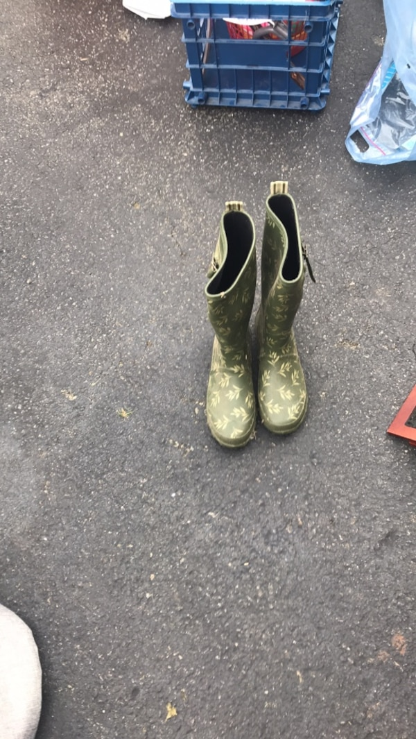 pair of green-and-black rain boots