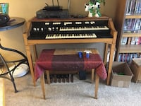 brown wooden framed black and white upright piano Colorado Springs, 80906