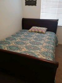 brown wooden bed frame with white and blue floral mattress Brampton, L6P 1V2