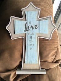 brown and blue wooden cross figurine with text
