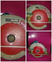One red and gray circular saw
