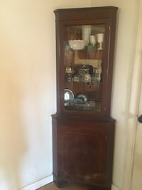 Antique corner cabinet with skeleton key. $75 takes the cabinet and glassware. Stones are not included. Linden, 22642