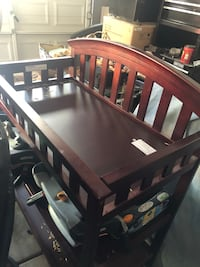 Baby's brown wooden changing table