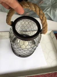 This is a very unique jug with chicken wire. I have a candle to use in it. Buford, 30519