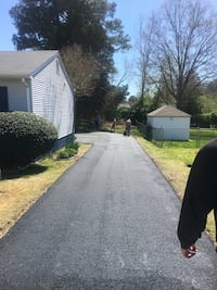 Professional equipment laid asphalt driveway message to meet for a free estimate Colonial Heights