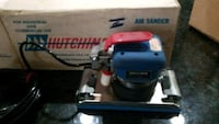 blue, gray, and red air sander with box