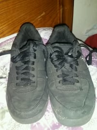 Pair of black U.S. Polo kids shoes. Low top.