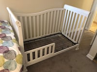 Baby's white wooden crib North Vancouver, V7P 3G7