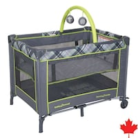 baby's brown and green travel cot Vaughan, L4L 2C1