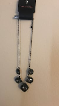 Silver-colored chain necklace with pendant