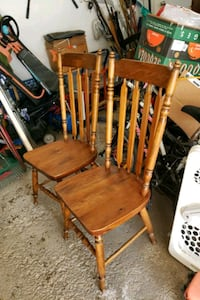 a pair of  wooden dining table chair