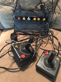 Black atari game console with controllers Northfield, 55057