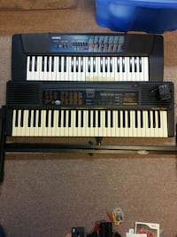 2 keyboards and a stand Brampton, L6X 1K7