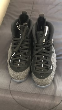 Size 11  Pair of black-and-gray nike air foamposite