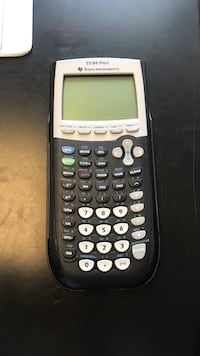 black and gray Texas Instruments TI-84 Plus graphics calculator