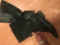 Knee top black boots with details in the back of heels  North Vancouver, V7K 2H4