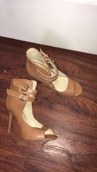 **Brand new** Pair of women's brown leather stilettos size 9