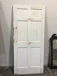 Solid wood door, sanded and ready for painting.