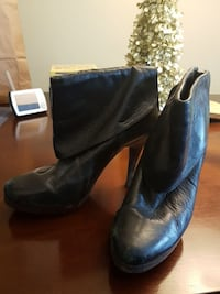 pair of black leather booties