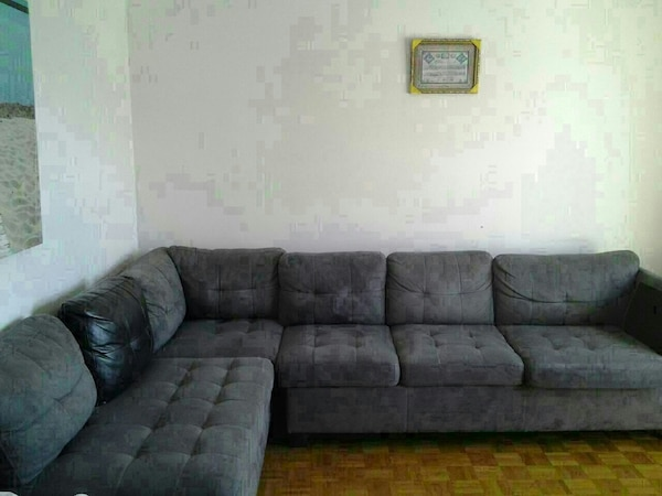 Used gray suede sectional couch with throw pillows for sale ...