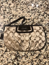brown and black Coach monogram wristlet Indian Trail, 28104