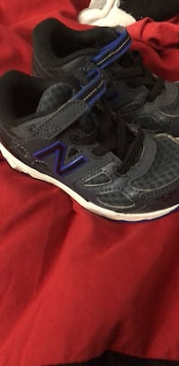 pair of black-and-purple Nike running shoes Louisville, 40299