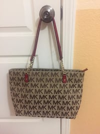 Authentic Michael Kors brown logo print canvas with red leather trim tote. Modesto, 95355