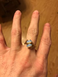 Opal look gems on a gold colored ring approx size 6? Wasilla, 99654
