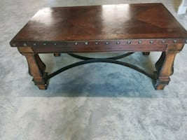 brown wooden frame glass top coffee table