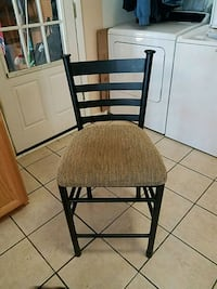 two brown wooden framed brown padded chairs 43 km