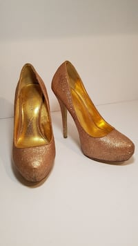 gold-colored leather platform stilettos