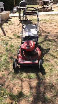 red and black push mower Lubbock, 79413