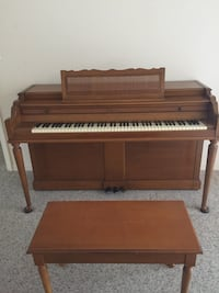 Brown wooden upright piano with chair Sarasota, 34239