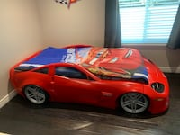Red Corvette bed with lights