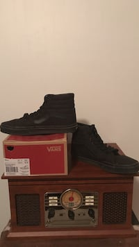 Pair of black high top Vans shoes