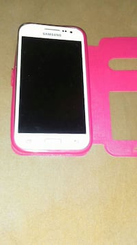white Samsung Galaxy Core Prime with pink flip case
