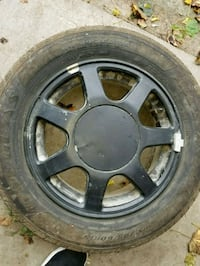black 5-spoke vehicle wheel and tire Cleveland, 44111