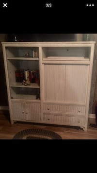white wooden TV hutch with flat screen television