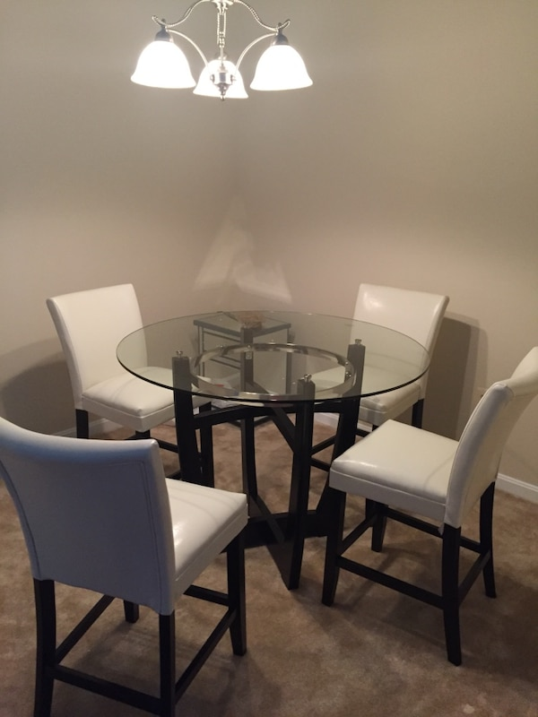 Contemporary, sleek round glass top dining set with 4 chairs!!!