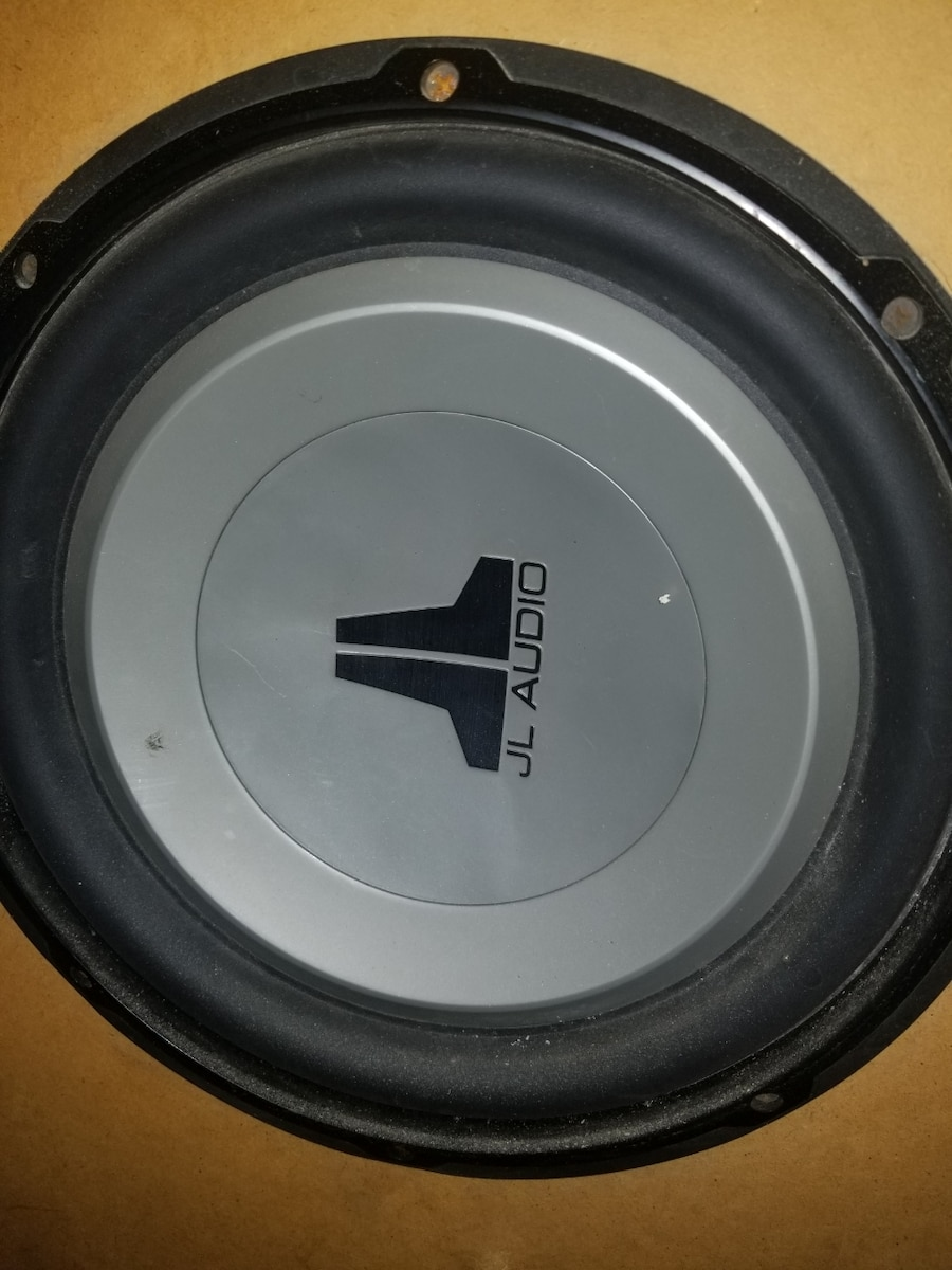 Photo 12 inch JL Audio subwoofer and tune ported enclosure. 400 watt amp