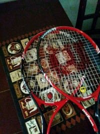 two red-and-black Wilson tennis rackets Washington, 20020