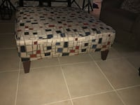white, black, and red plaid fabric ottoman 43 km