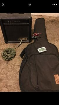 Acoustic guitar case/ 2 capos/ supra flex 15' cord/ mini amp and tuner Redlands, 92374