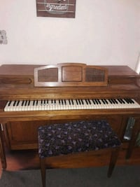 Cable upright piano and bench